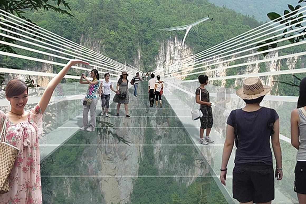 An artist's concept of people walking across the glass bridge high above the Zhangjiajie canyon in China