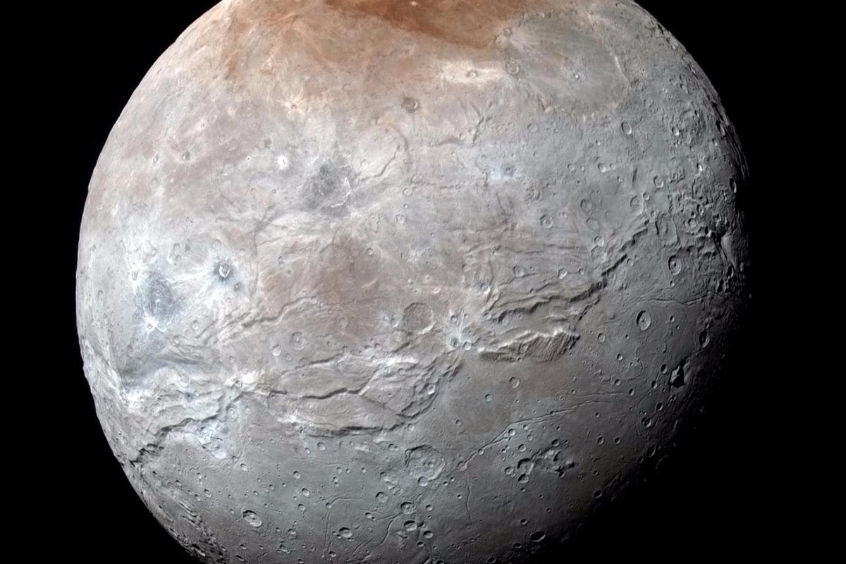 Image of Pluto's moon Charon, taken by New Horizons. This new high-resolution image taken by the spacecraft's Ralph/Multispectral Visual Imaging Camera (MVIC) contains geological features down to a scale of 1.8 miles (2.9 km)