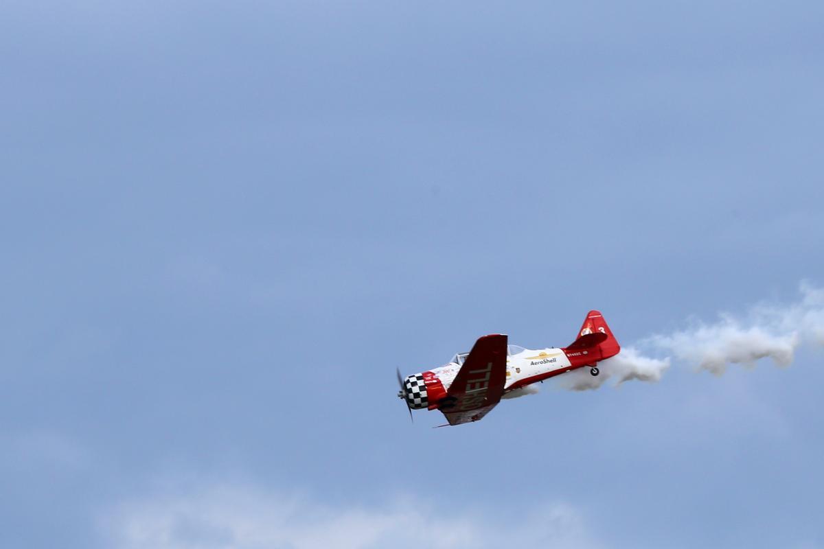 A Honda badged aerobatic plane performs at EAA AirVenture 2014 (Photo: Angus MacKenzie/Gizmag.com)