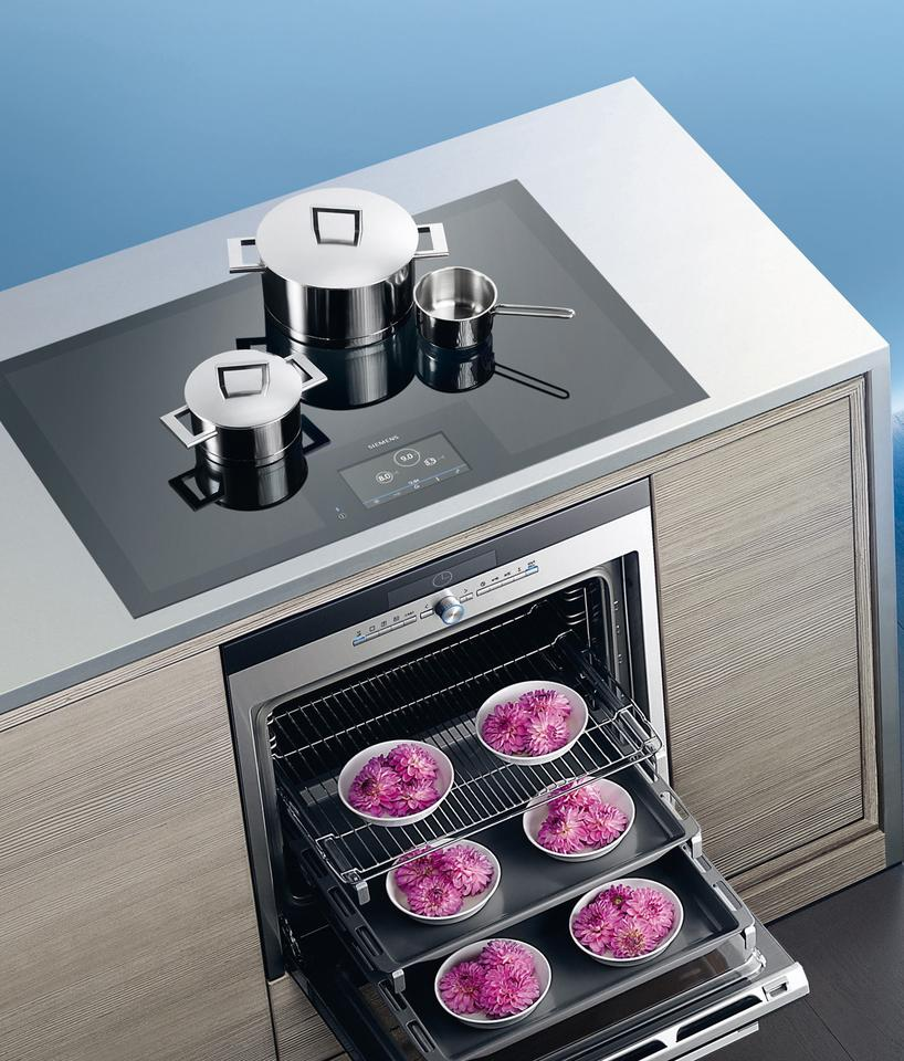 Siemens offers its full-surface induction cooktop in surface-mounted (pictured) and flush-mounted versions