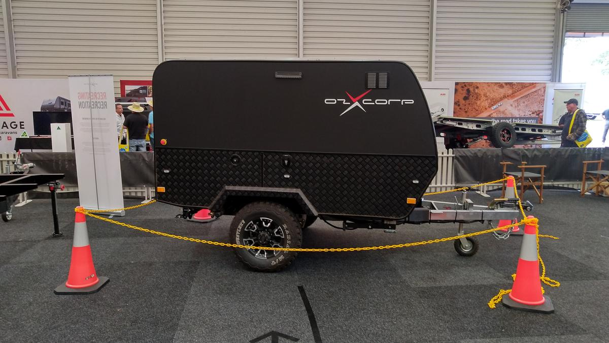 Electric AWD camping trailer self-drives over pavement and muddy trail