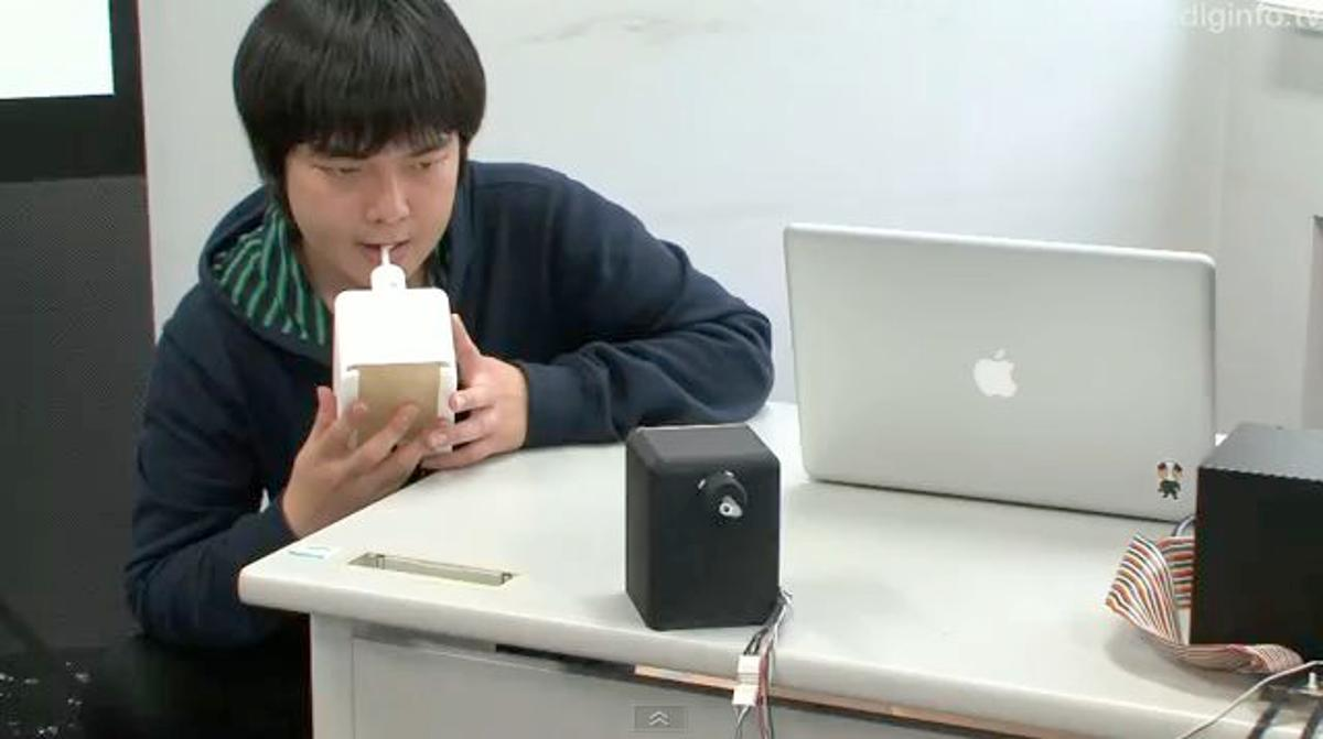 A student at Tokyo's University of Electro-Communications has invented a robotic tongue device for online kissing (Image: DigInfo News)