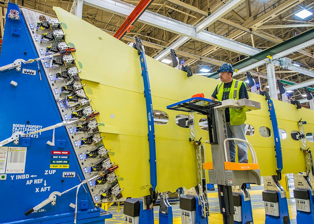 737 MAX wing skin panels and stringers being loaded into Boeing's into the new panel assembly line that uses automation to drill holes and install fasteners