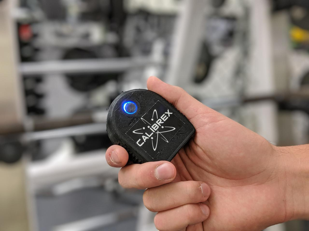 The Calibrex sensor units swivel relative to the barbell, so they remain facing down at all times