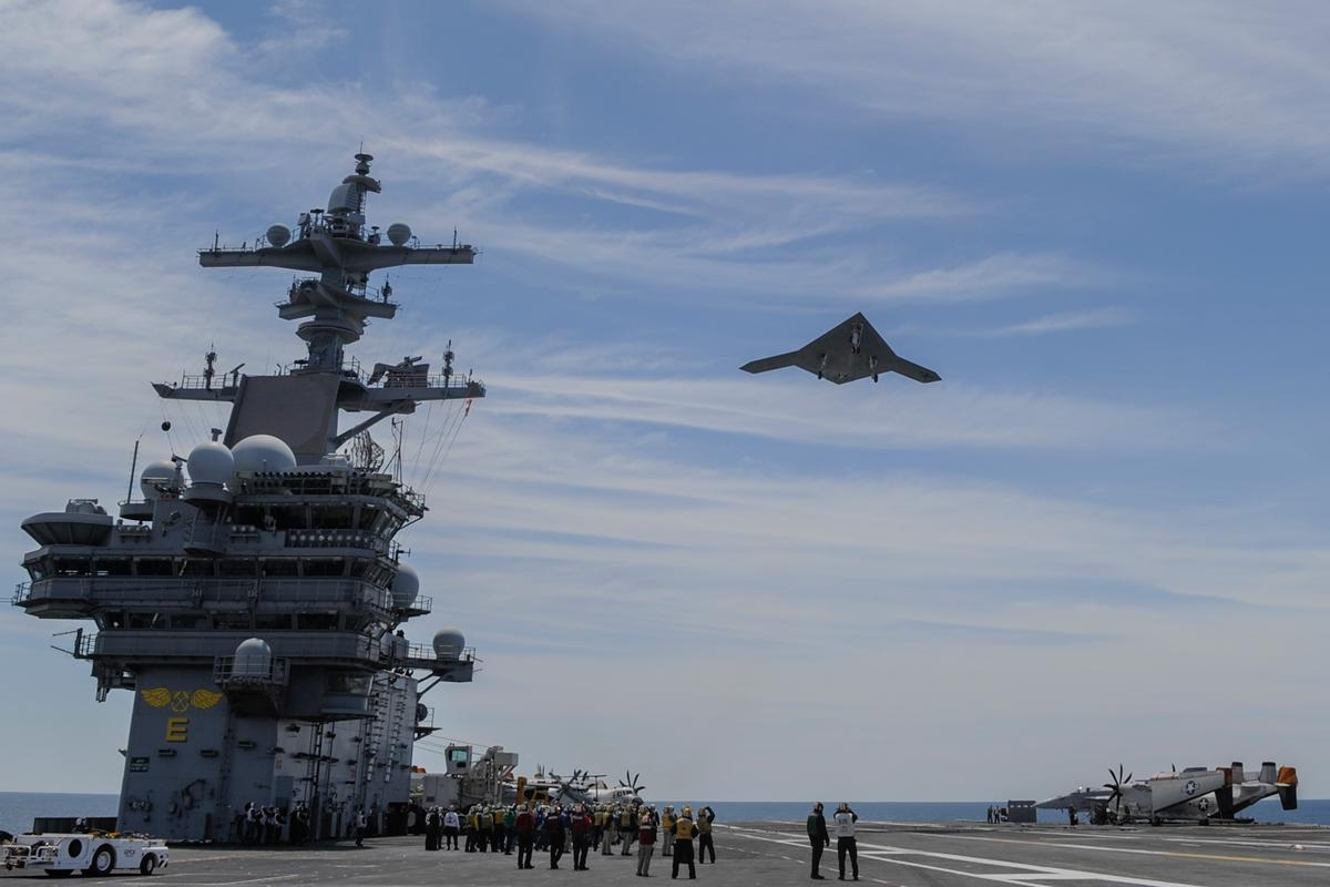 X-47B flies over the aircraft carrier USS George H.W. Bush (CVN 77) (Photo: US Navy courtesy of Northrop Grumman by Alan Radecki)