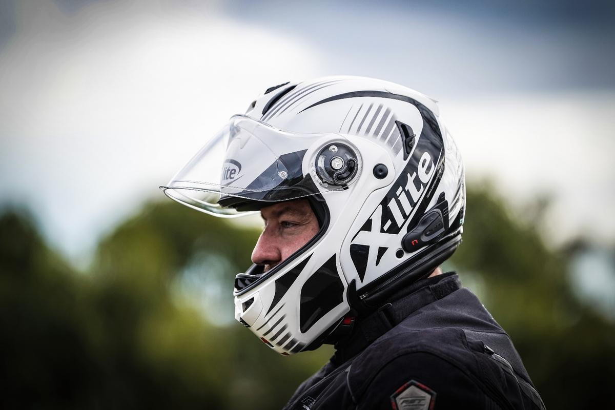 The X-Lite X1004 with NCOM BX-5 isflip-face composite sports touring helmet with integrated Bluetooth comms