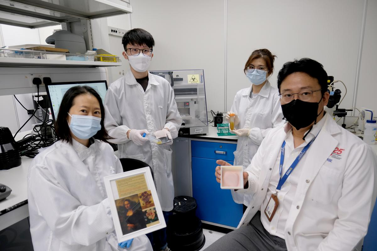 The research team, with tubes of the bio-ink (rear)