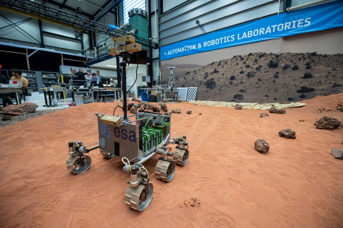 ExoMars Testing Rover (ExoTeR), seen maneuvering itself carefully through the red rocks and sand of the Planetary Utilisation Testbed