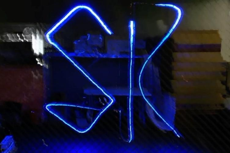 A timed exposure of a DroneLight-using quadcopter writing the letters S and K in the air