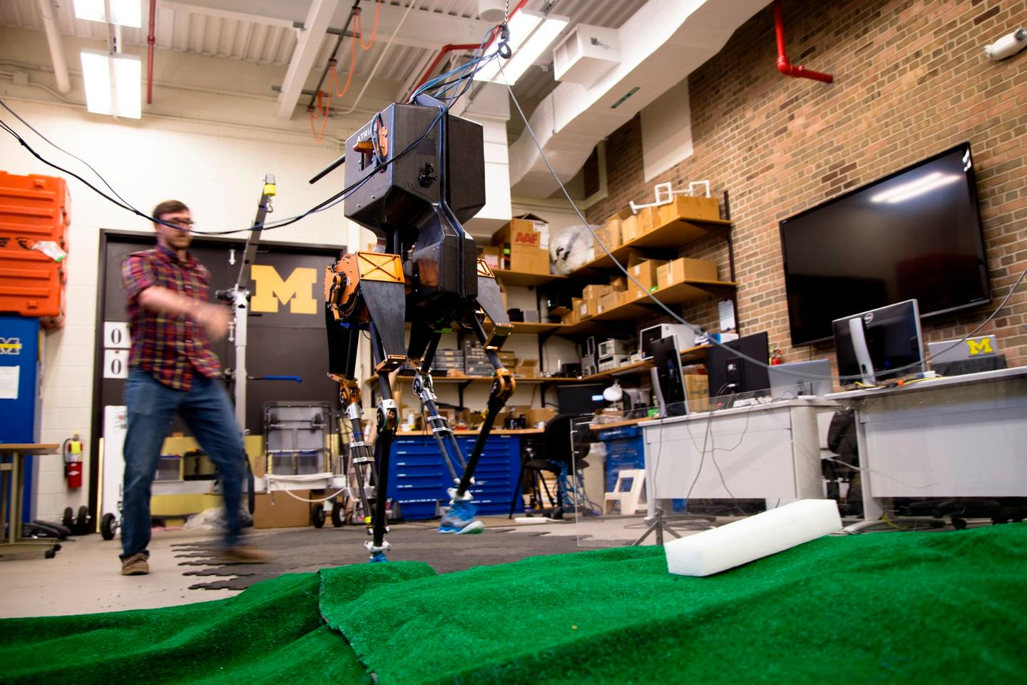Robotics PhD student Ross Hartley watches as MARLO demonstrate's her ability to conquer tough terrain.