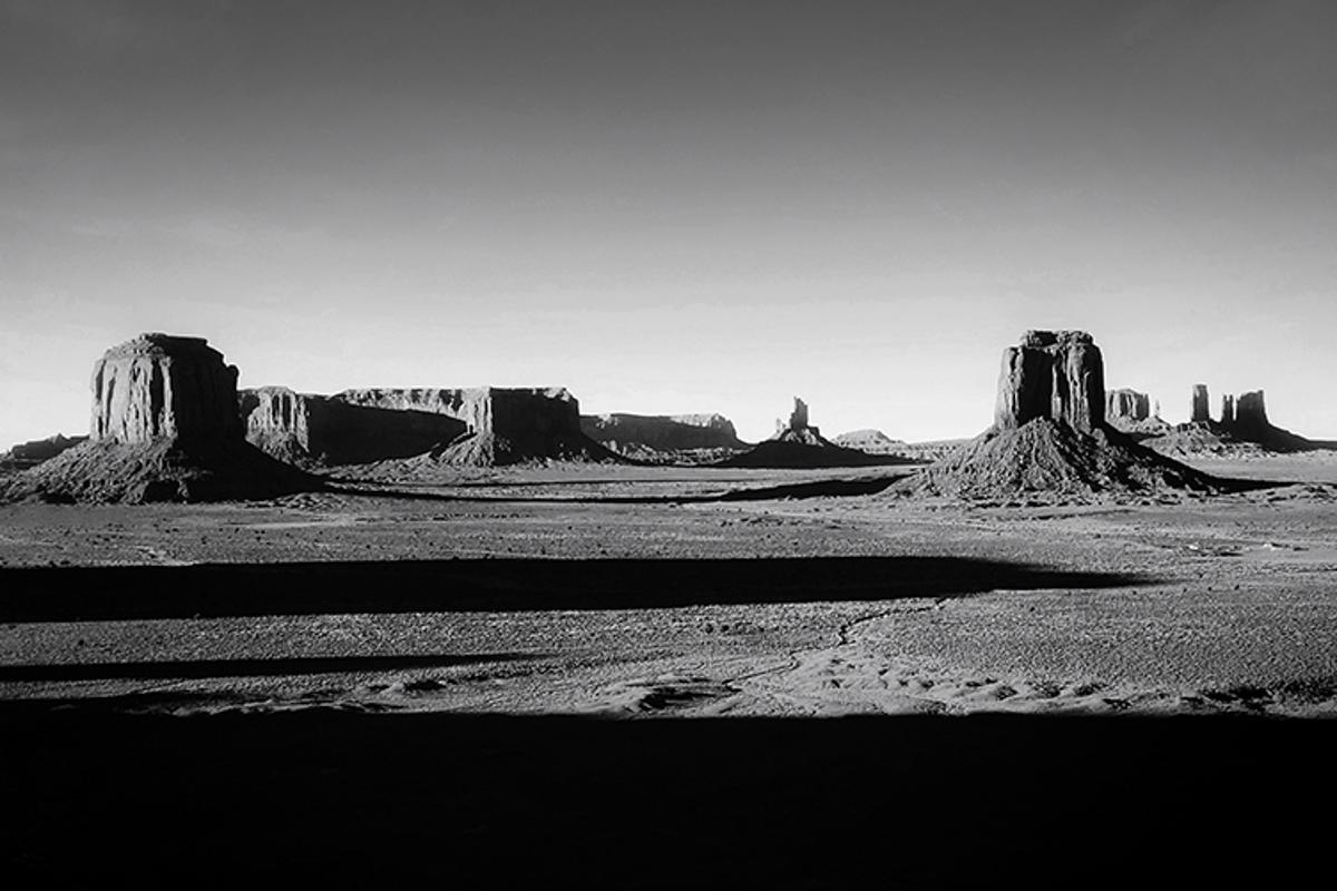 "From the 2019 iPhone Photo Awards. ""View from Artist's Point in Monument Valley, where the ground falls away steeply and the flat land stretches ahead for many miles, punctuated by the peaks of buttes, mesas and pinnacles in distance."""