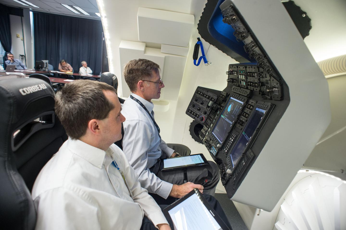 Chris Ferguson (center) at the simulator controls