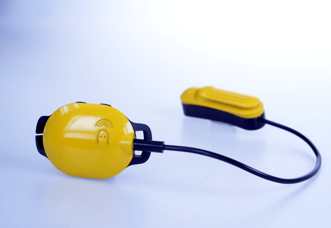 Marlin's waterproof main control unit attaches the user's goggle strap, and is hard-wired to the earpiece