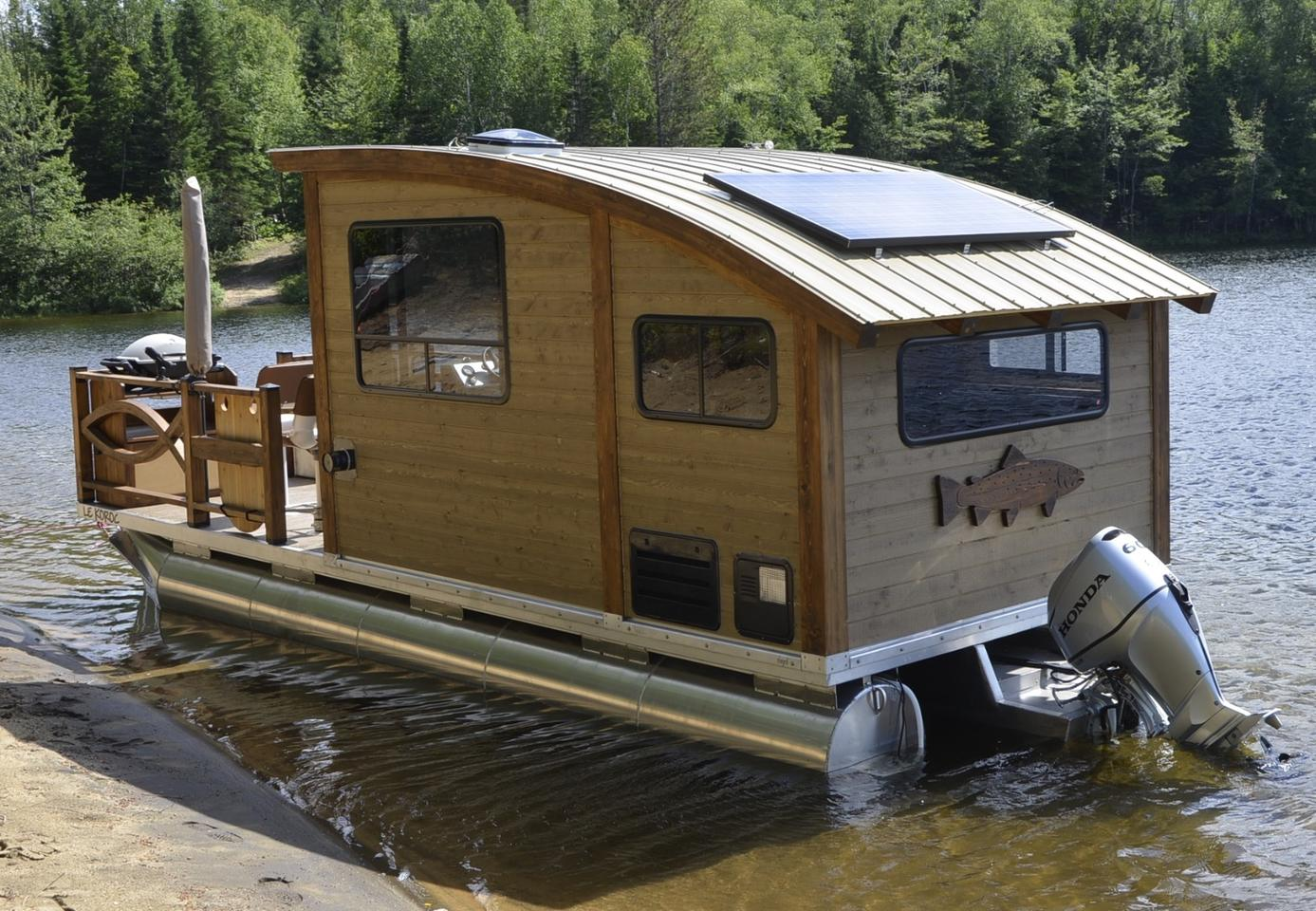 Solar powered houseboat takes tiny living to the water