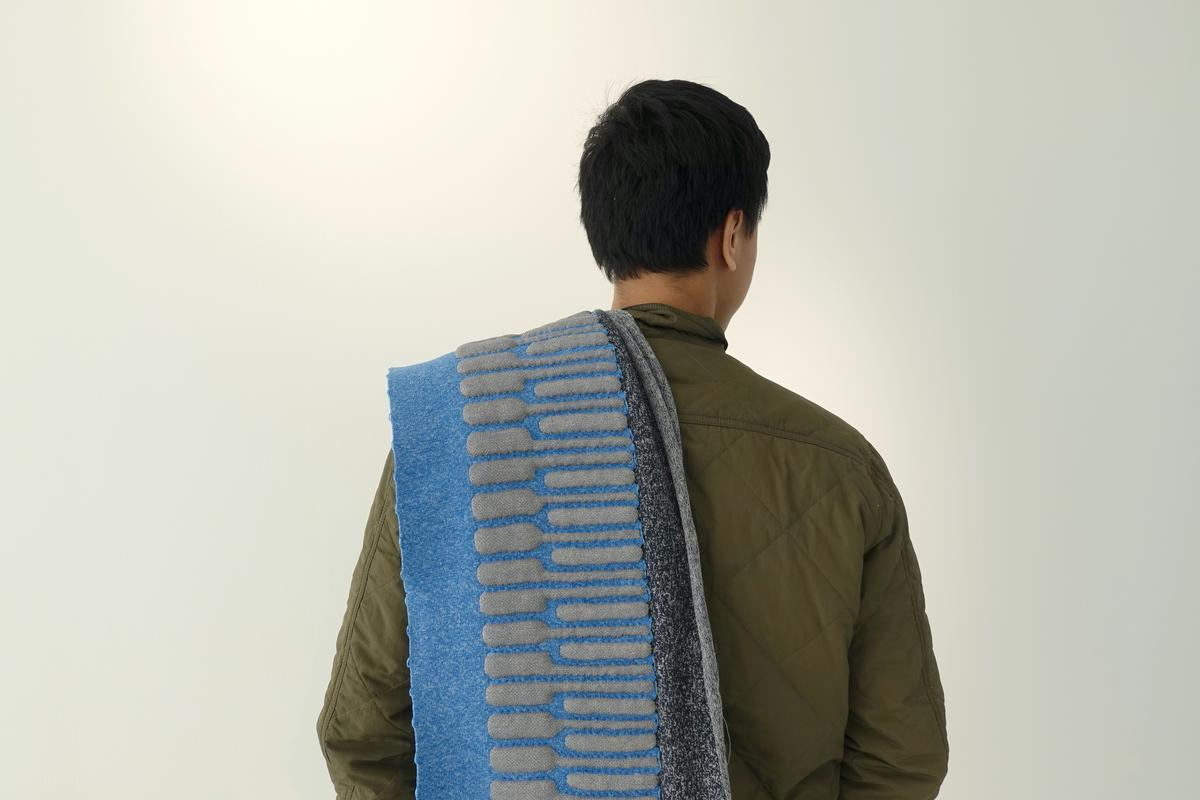 The KnittedKeyboard II can be thrown over the shoulder like a scarf, or can be cabled up to a laptop running music production software and used as an expressive MIDI keyboard