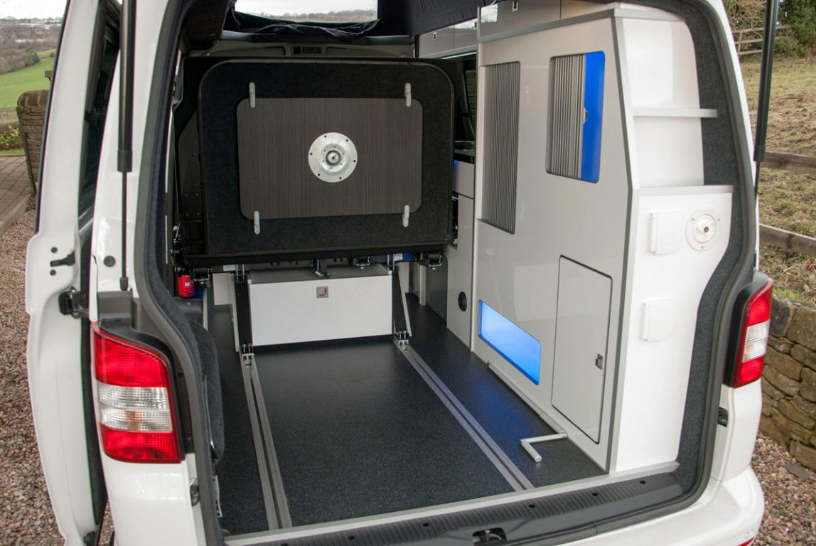 The rear seat of the Volksleisure camper slides forward to open up cargo space