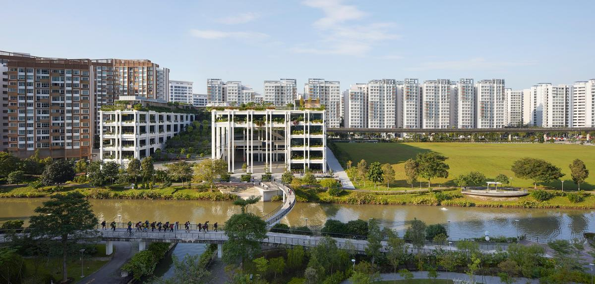 Oasis Terracestakes its place remarkably well amongthe surrounding buildings in Punggol, Singapore