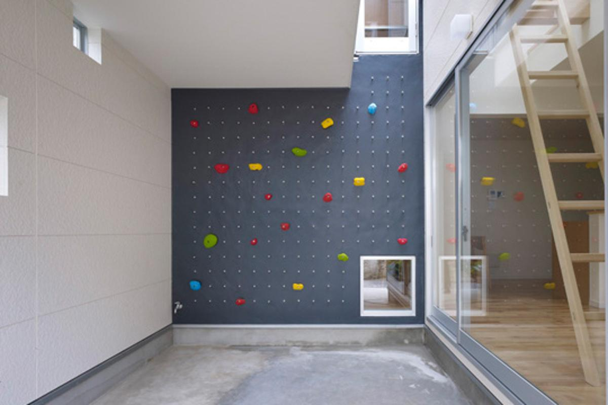 Located in a suburban area in Tokyo, 3way House is creative family home featuring a series of climbing walls and ladders