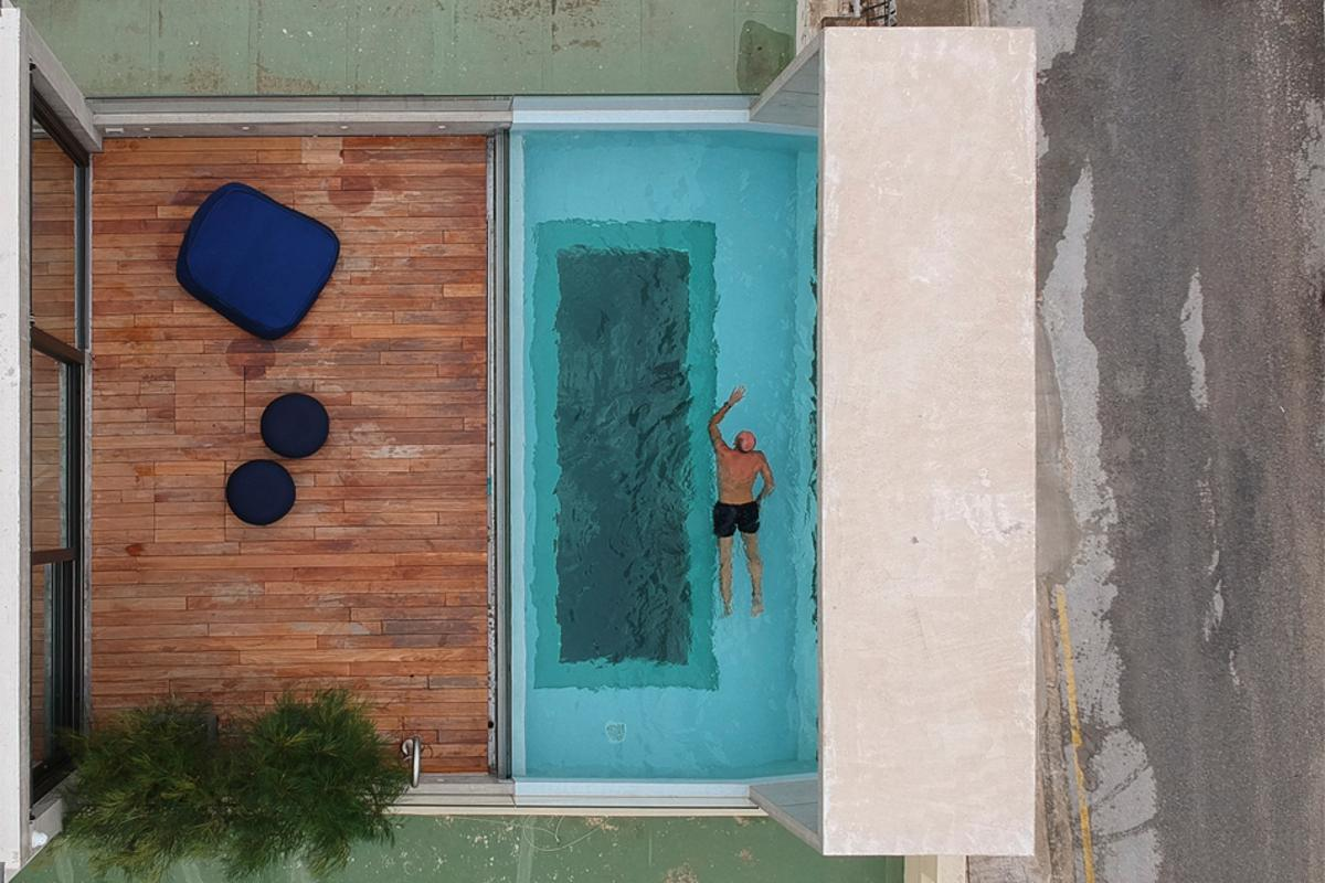 Casa B's rooftop pool offers a view of the home's interior below