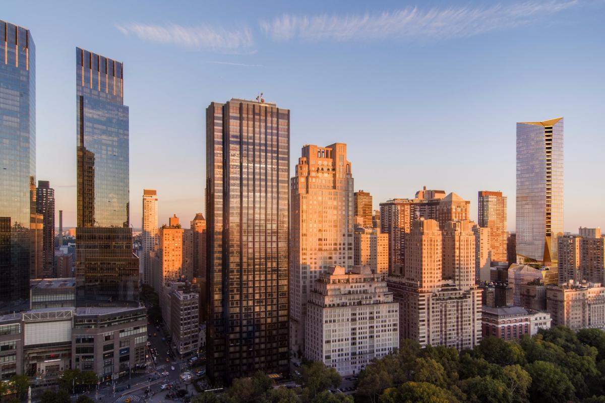 The tower to be constructed at 50 West 66th Street, seen on the right, will be finished in limestone, bronze and glass