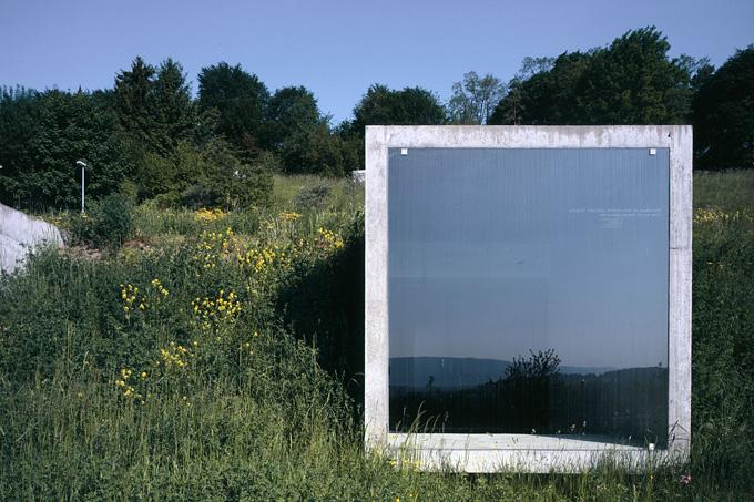 The concrete cubes are furnished with a single glass panel window, creating a dramatic outlook onto the adjacent valley