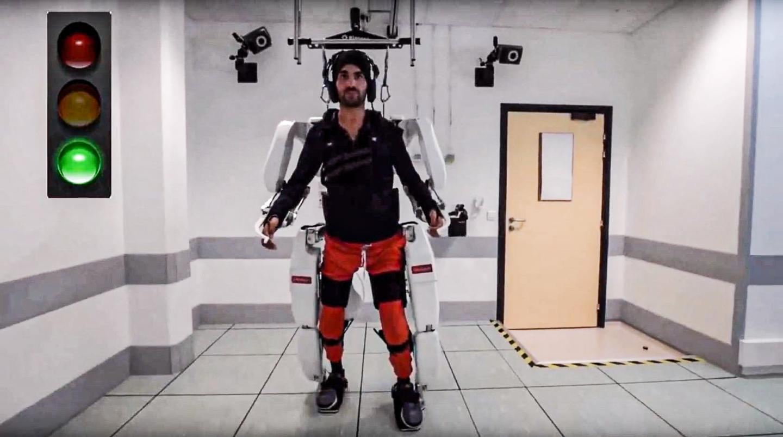 A quadriplegic patient walks using a brain-controlled AI exoskeleton