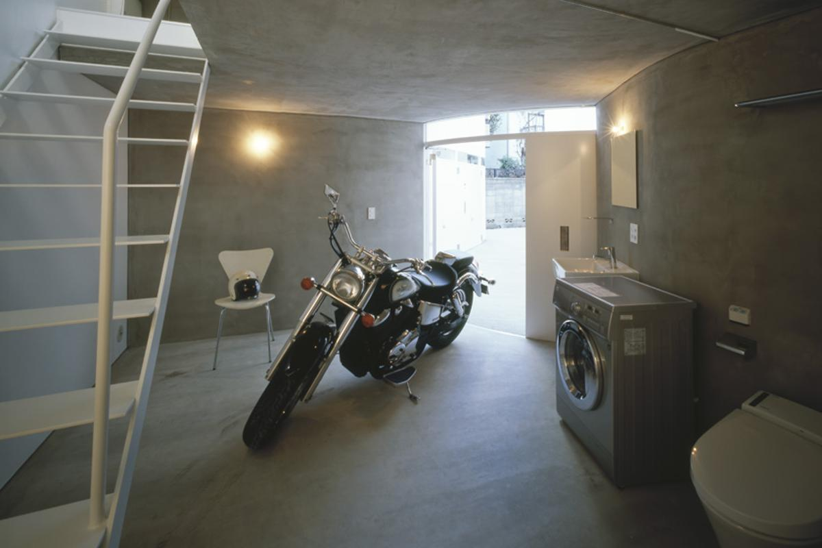 Bathrooms often double up with the garages at ground level, which saves space by elimintating the need to run pipes vertically through the apartment, but does mean residents will share quality getting-to-know-you time with their choppers