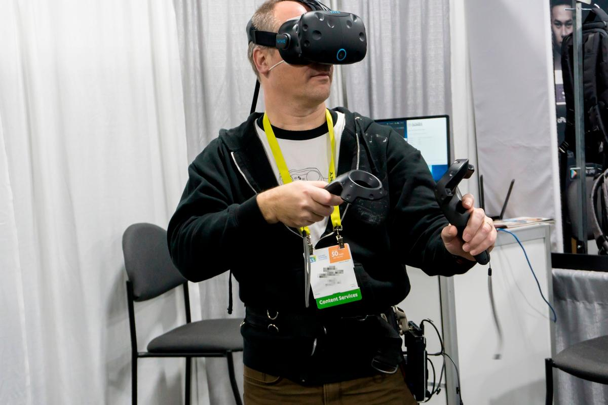 A CES attendee demoing KwikVR's wireless adapter for the HTC Vive and Oculus Rift