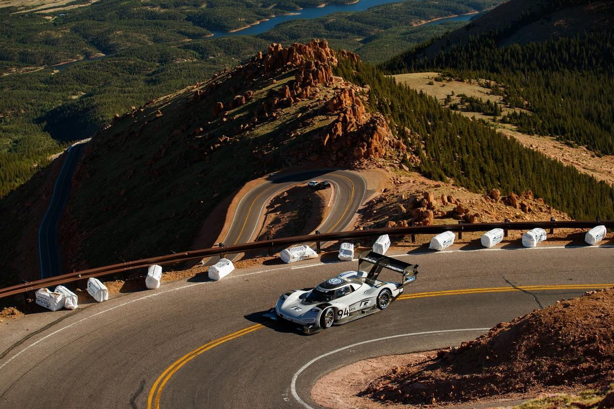 Romain Dumas and the Volkswagen I.D. R race car working their way up Pikes Peak fast enough to take the win and the all-time record