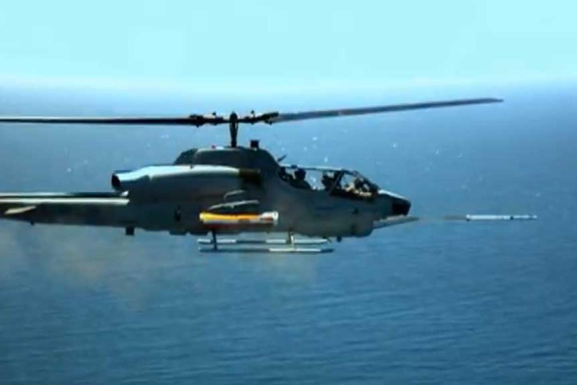 Test firing of an LCITS rocket from an AH-1 Cobra helicopter