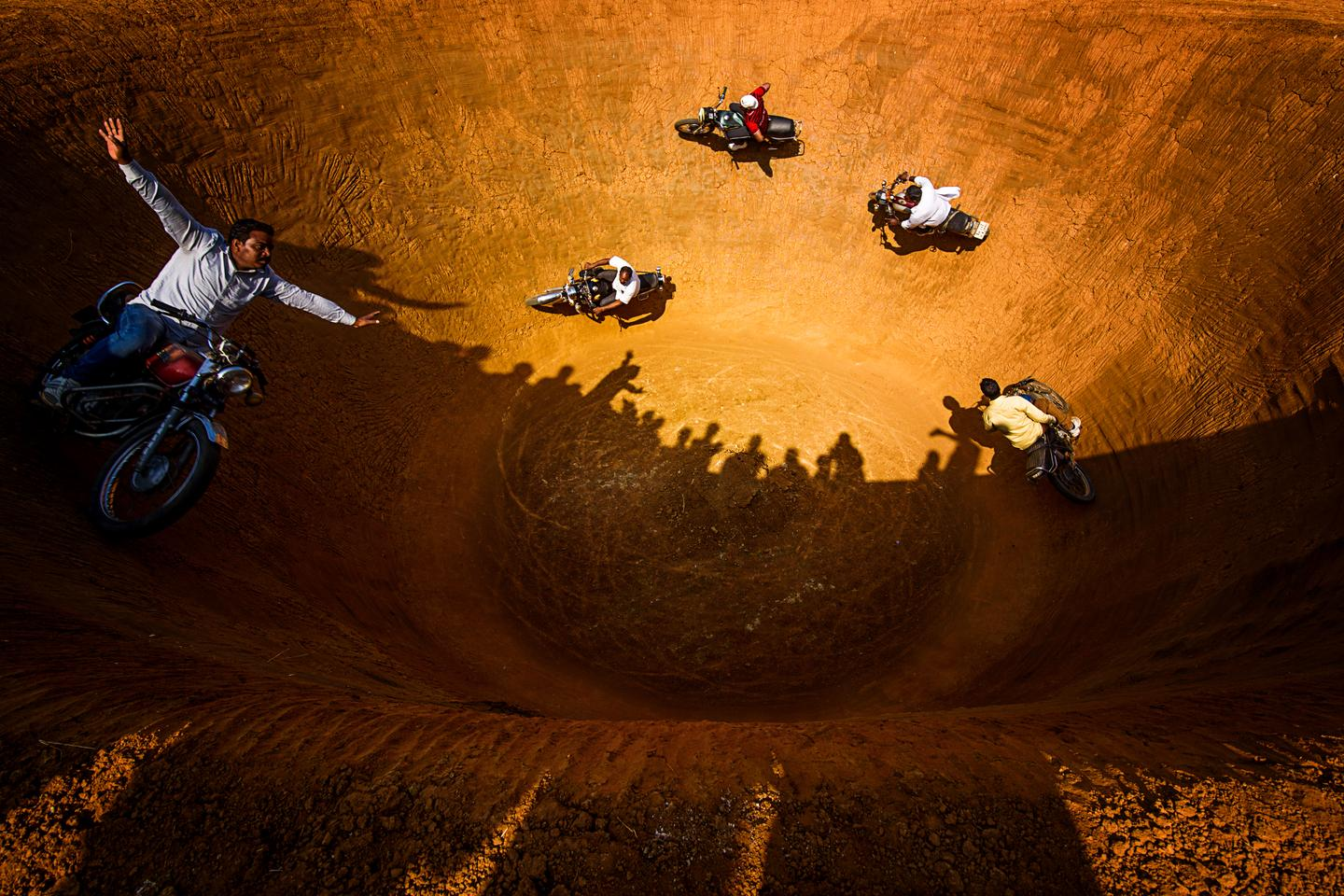 "Finalist, People. ""Death of Well"". The ""wall of death"" or ""well of death"" is a common game now at fairs and carnivals in India, though it first originated in America. Motorcyclists circle the well again and again"