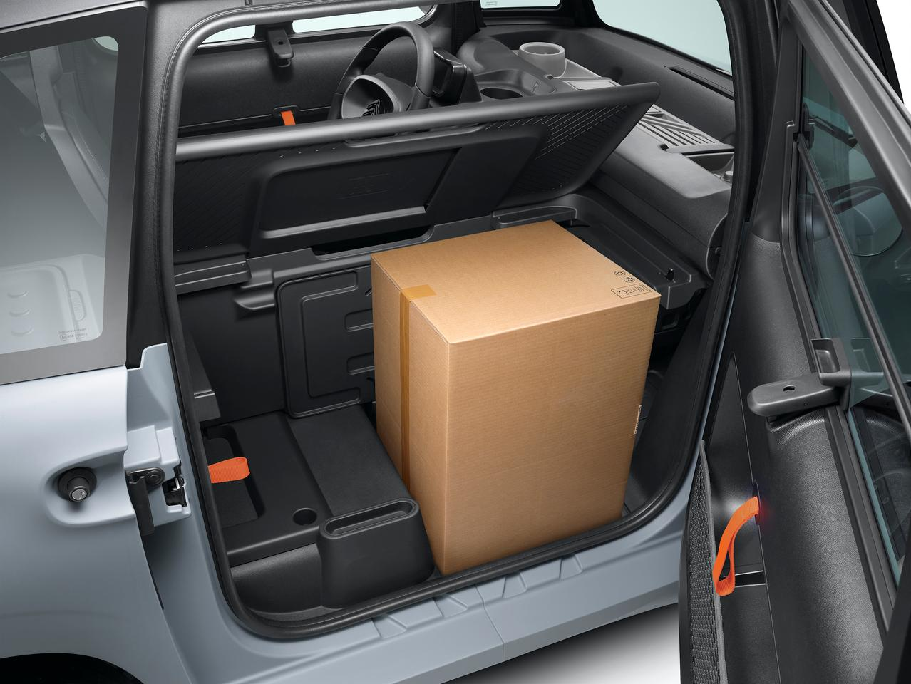 The passenger space has been replaced by a modular storage compartment