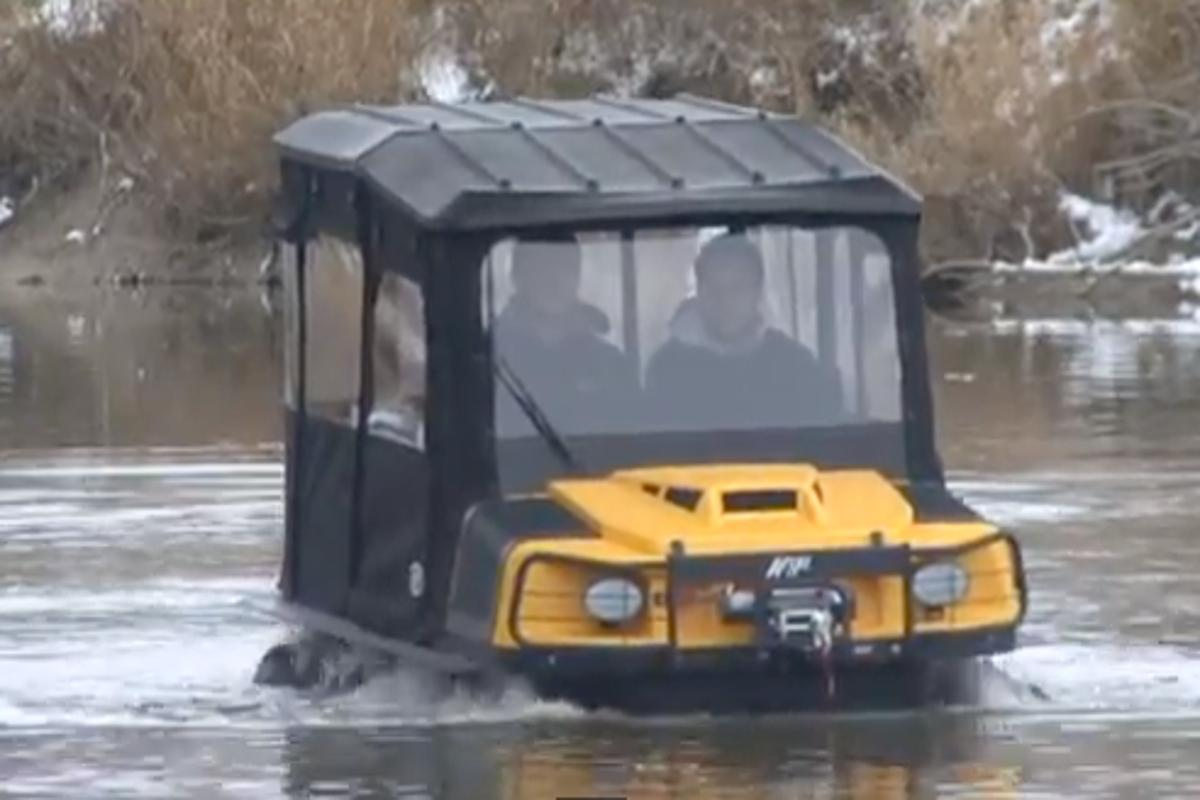 An ARGO XTI with available canopy shows off its water skills