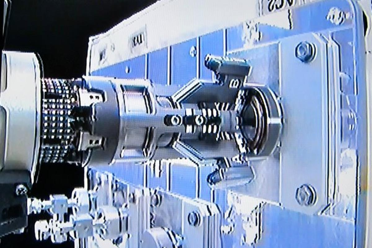 The Multifunction Tool uses its attached adapter to manipulate a plug located under the Ambient Cap on the RRM module (Image: NASA/CSA)