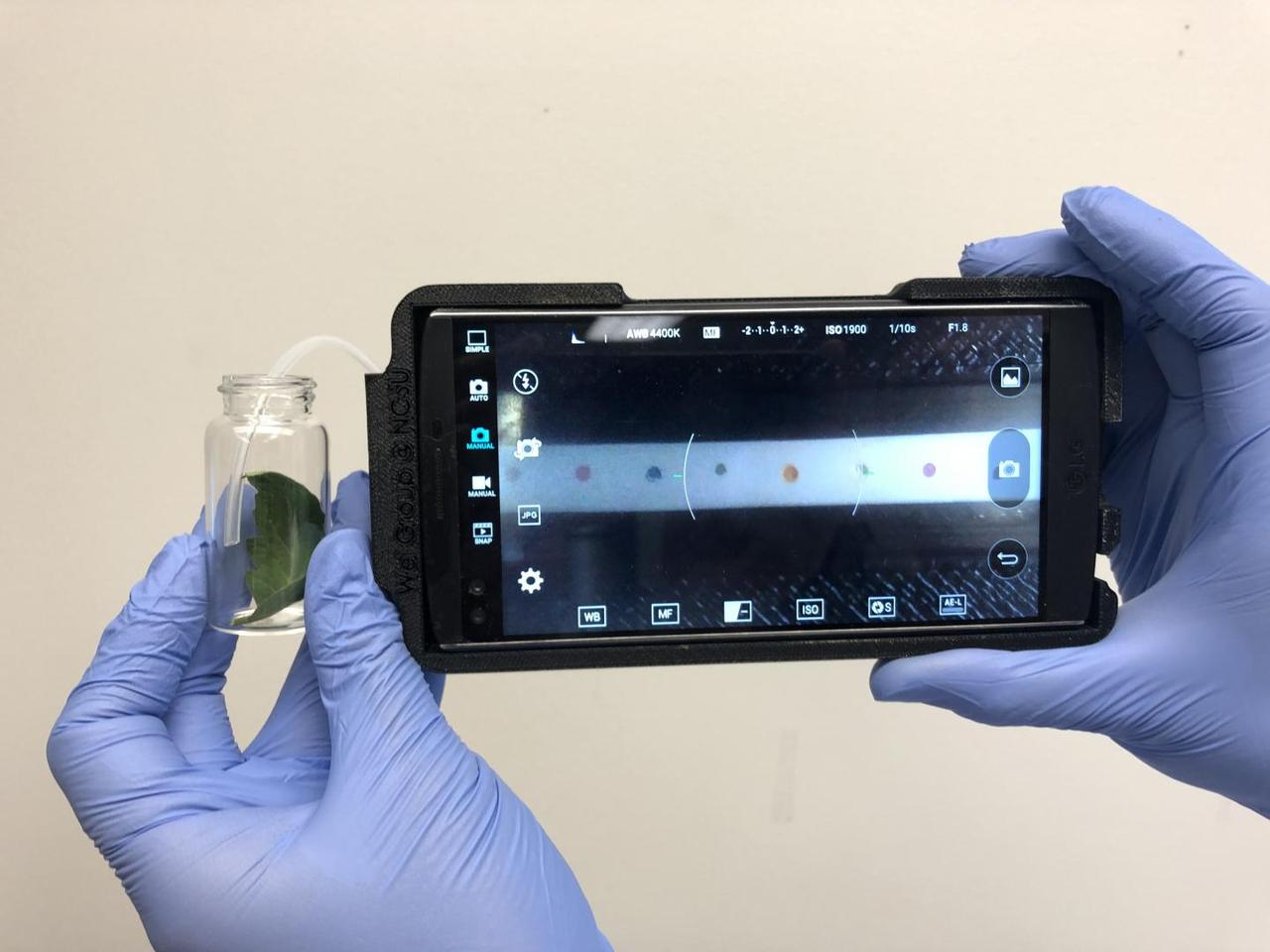 Attached to a smartphone, the device analyzes VOC-laden air from a separate test tube