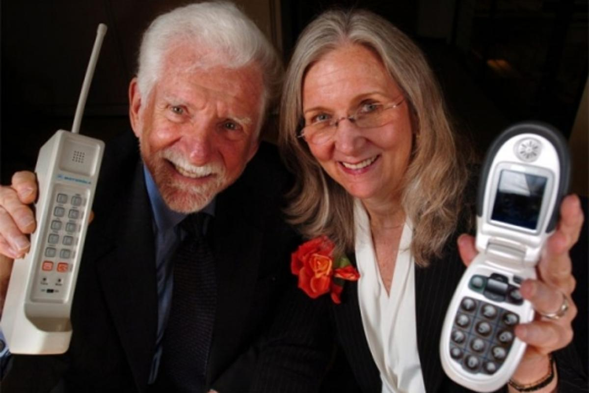 Martin Cooper and his wife and business partner Arlene Harris with their respective cell phone inventionsPhoto: Business Wire