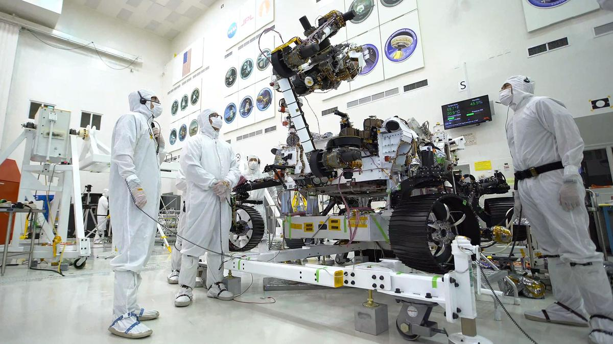The rover's 7-ft-(2.1-m) arm maneuvers its 88-lb (40-kg) sensor-laden turret as it moves from a deployed to a stowed configuration
