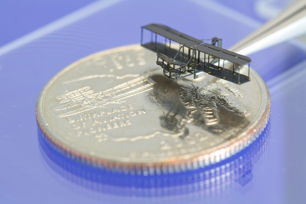 The PC-MEMs manufacturing method, developed at Harvard Microrobotics Lab, was used to create this tiny model of the Wright brothers' bi-plane