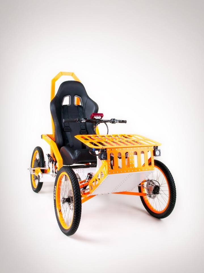 The EV4 Mountain Cart rides on four 20 inch wheels wrapped wrapped in 20x2.125 Kenda tires, with four bicycle shocks to help smooth out the bumps