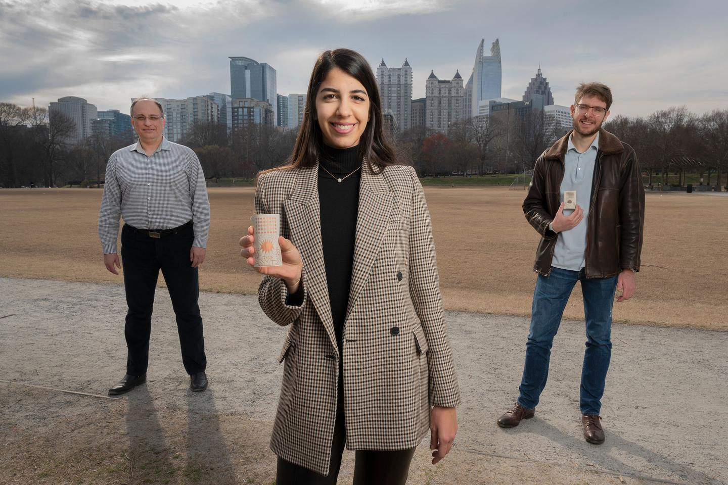 Georgia Tech researchers Aline Eid (center), Manos Tentzeris (left), and Jimmy Hester (right) have developed a flexible Rotman lens-based rectifying antenna system for 5G energy harvesting that could eliminate the world's reliance on batteries for powering devices.