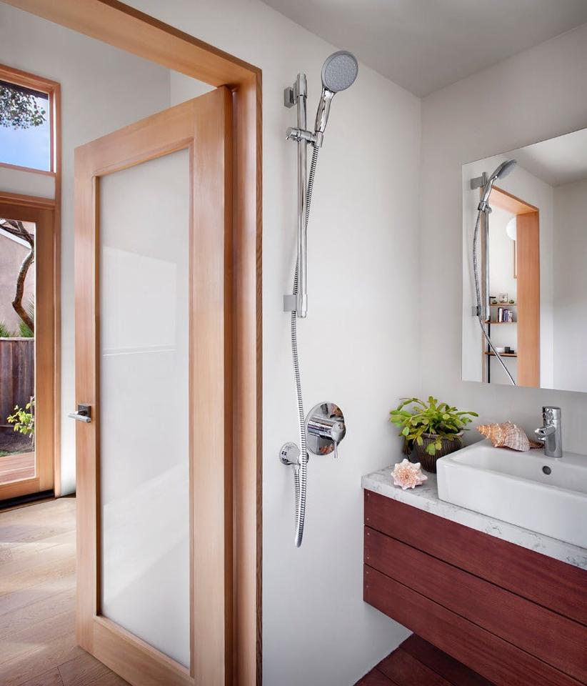 The snug bathroom inside the Britespace flatpack home includes a shower, toilet, and sink