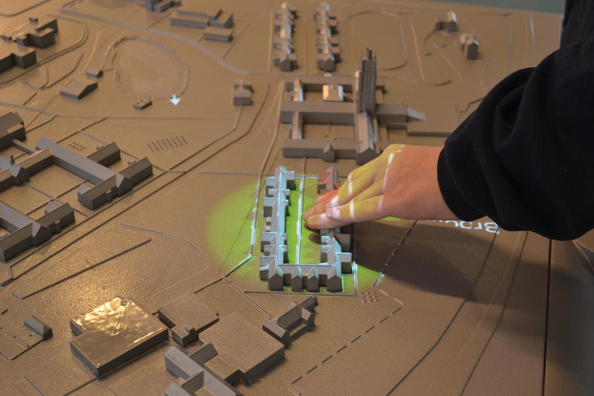 Multi-sensory 3D maps give spoken directions and building information when touched, along with sound effects and overhead video projection related to a particular place (Photo: University of Buffalo IDeA Center)