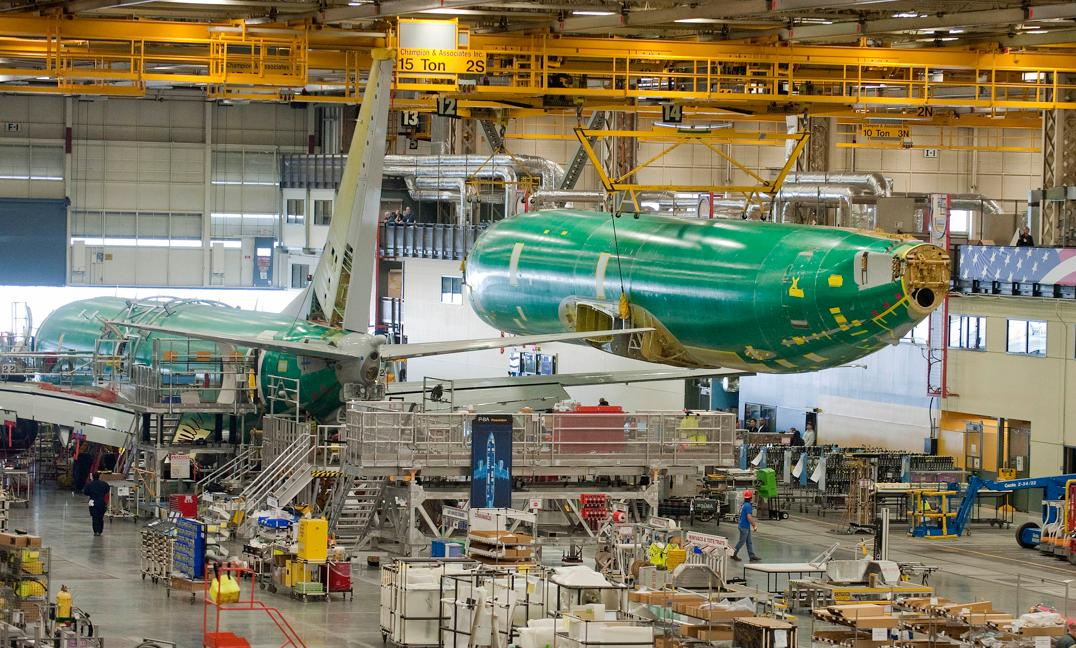 The fuselage for the first P-8A Poseidon production aircraft. The sixth test aircraft T6 is in final assembly in the background (Photo: Boeing)