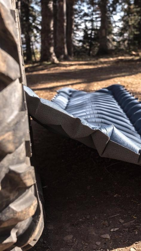 "The Klymit Armored V relies on a ""SuperFabric"" bottom to hold up to the rough, uneven terrain below the tent floor"