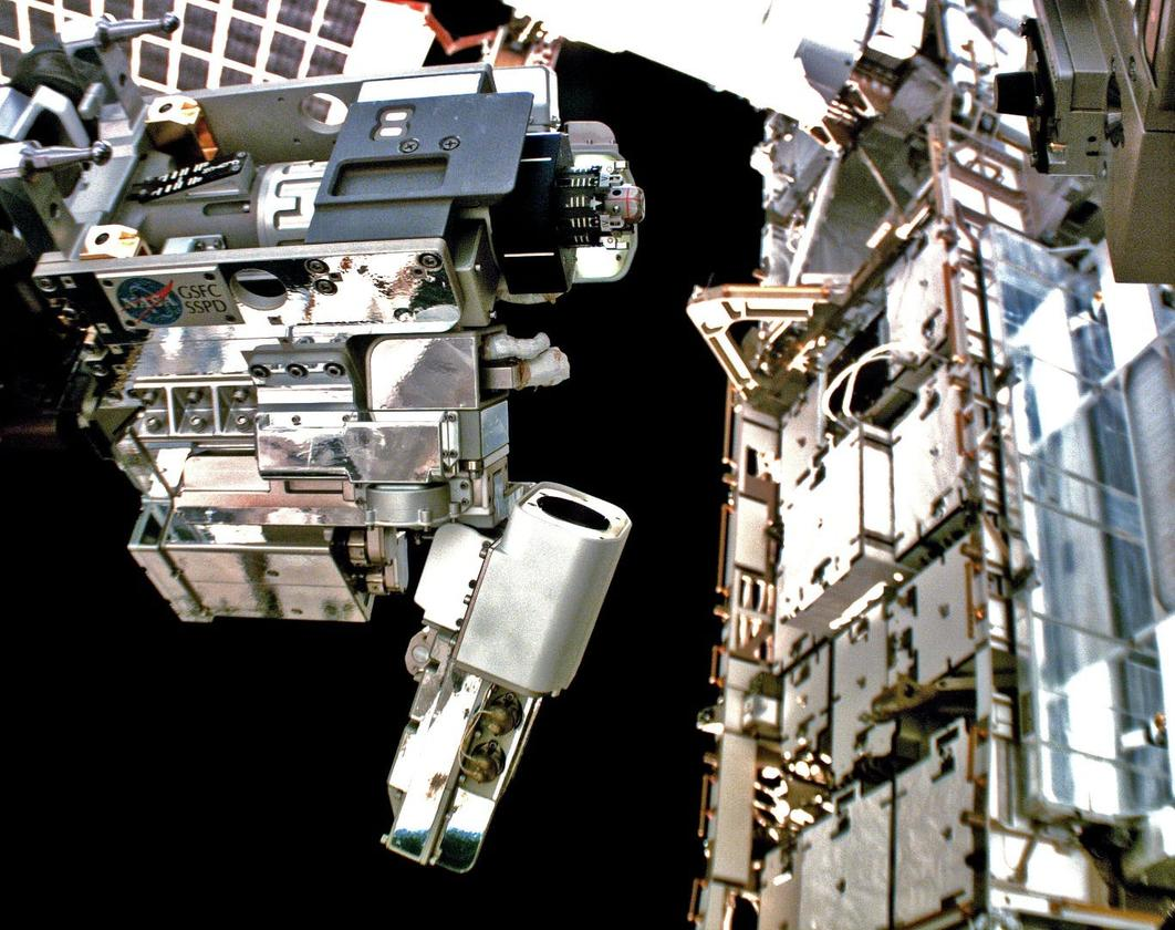 Robotic Refueling Mission 3's Multi-Function Tool 2, operated by Dextre, demonstrates robotic refueling operations on the outside of space station