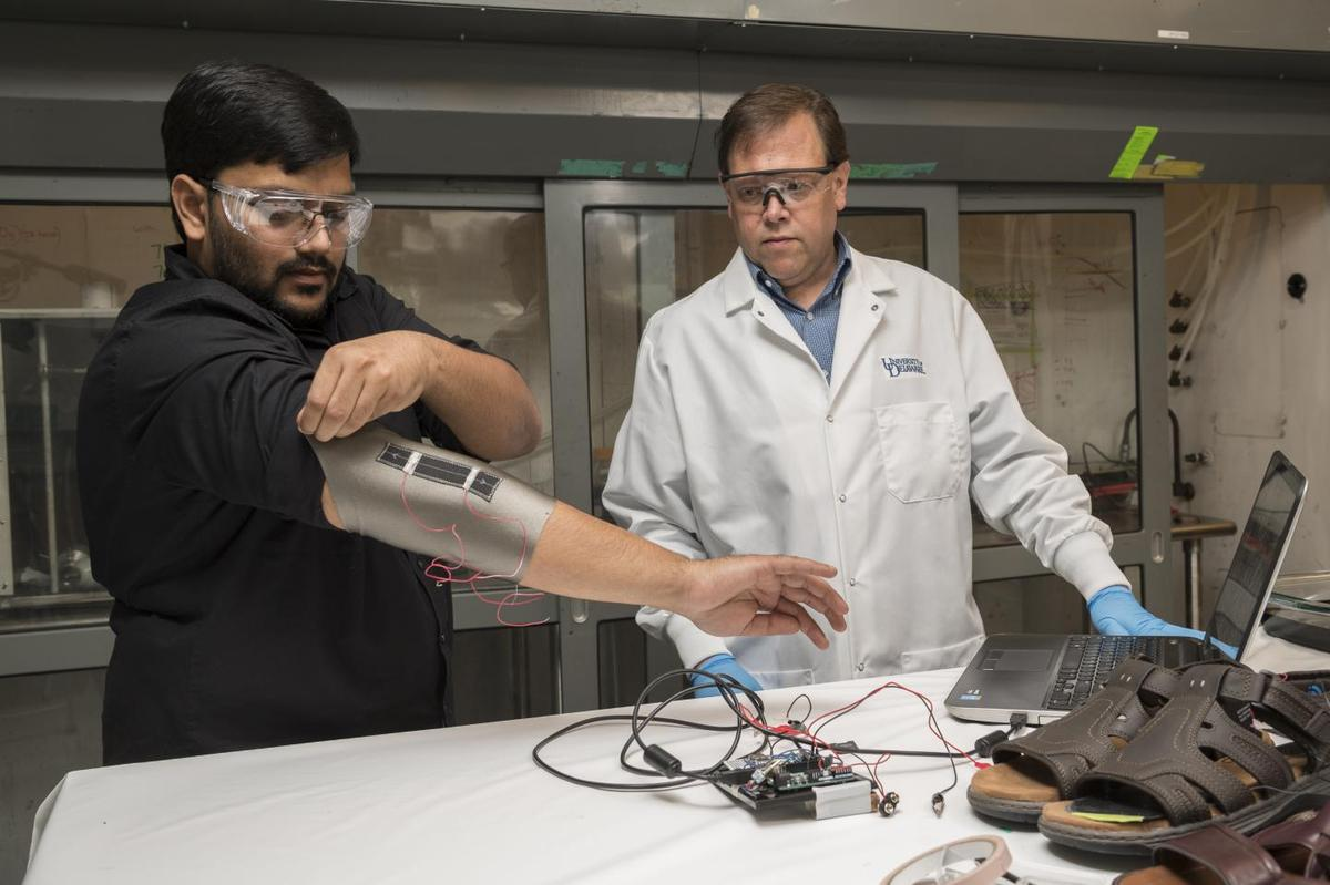Sagar Doshi (left) and Erik Thostenson test an elbow sleeve made with the material