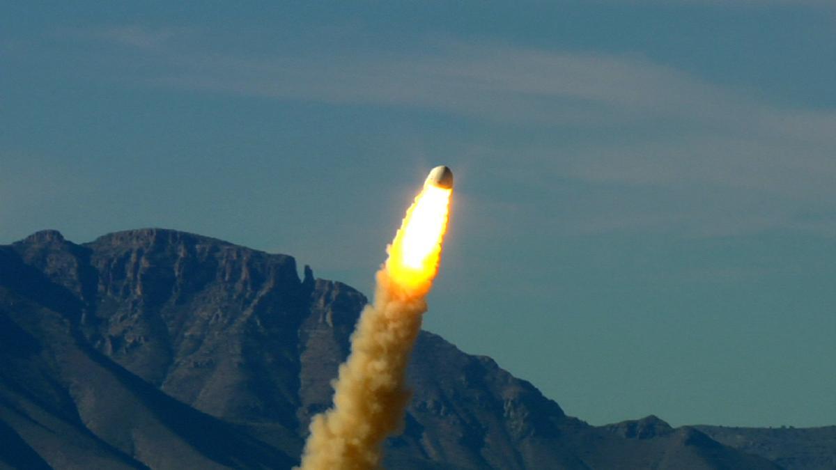 Blue Origin's New Shepard crew capsule shoots free of the launch vehicle simulator