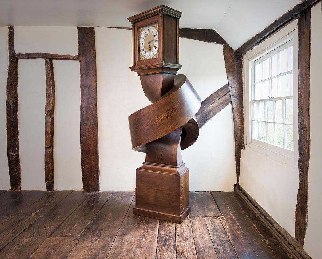Growing up gets me down contorts a grandfather clock into an unlikely position