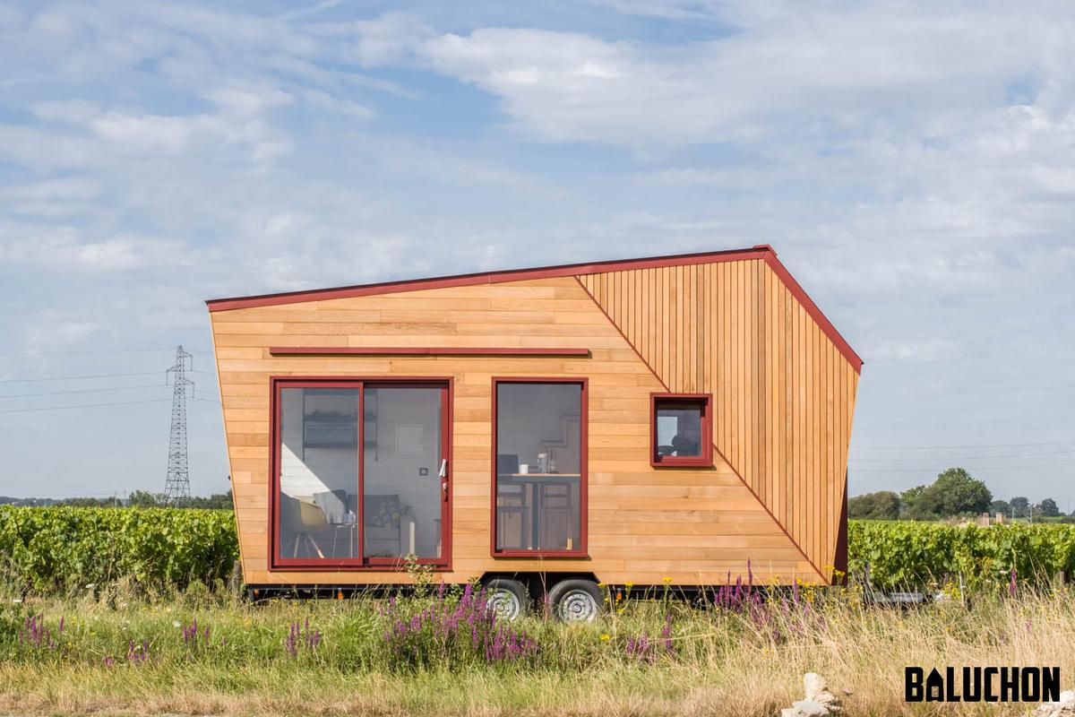 Tiny House Insoumise measures a total length of 6 m (19.6 ft) and finished in cedar, with aluminum detailing and roof