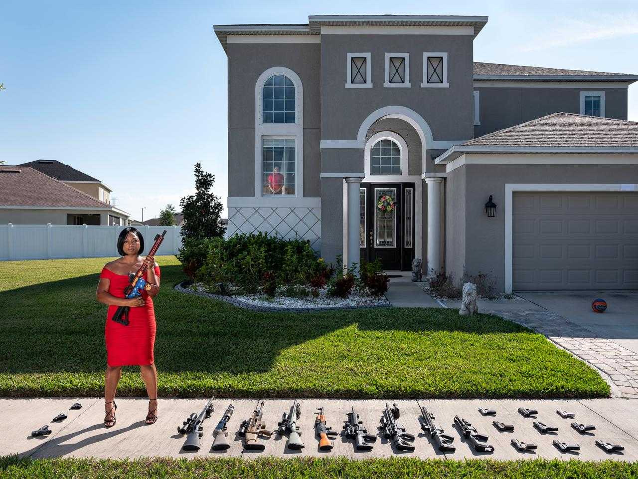 2nd Place - Avery Skipalis (33), outside of her house, posing together with all the firearms she owns, Tampa, Florida